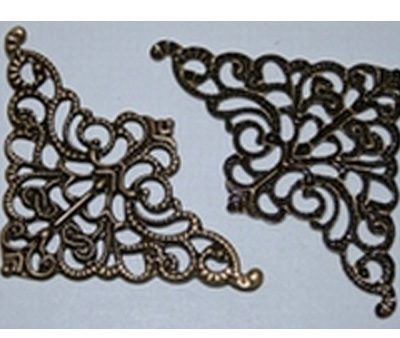 Esquina de bronce - ornamentación de tapas